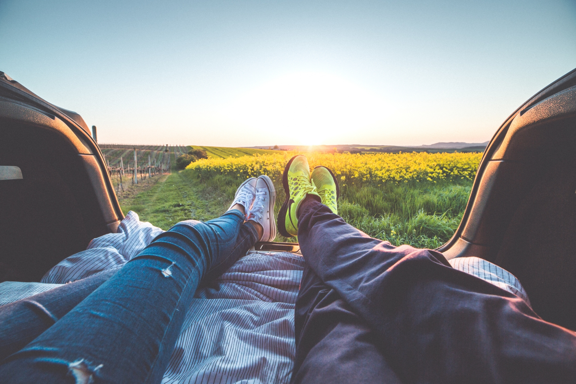 young-couple-enjoying-romantic-sunset-from-car-trunk-picjumbo-com.jpg