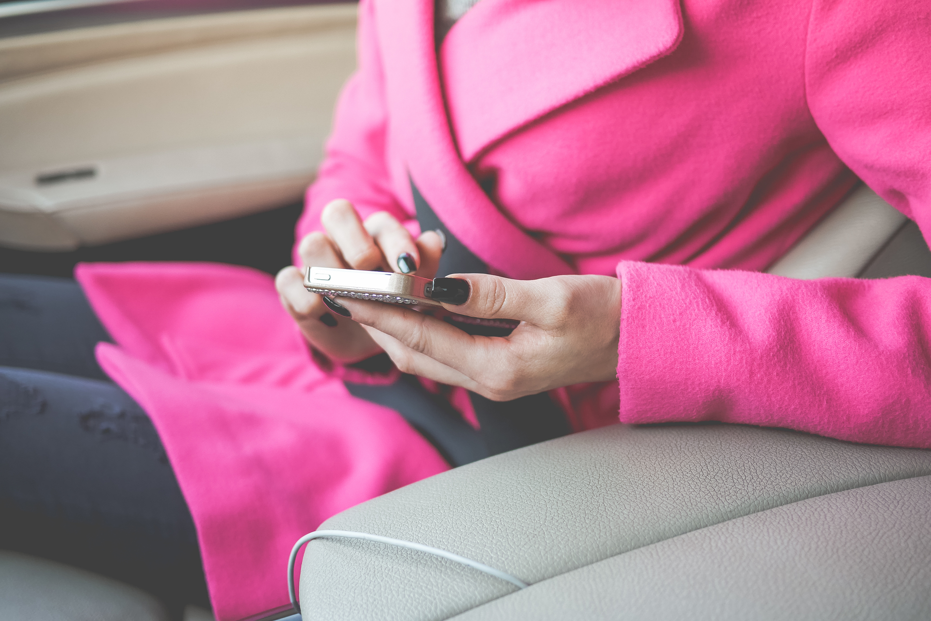 nicely-dressed-woman-using-her-phone-in-a-car-picjumbo-com.jpg