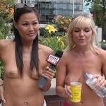 カナダのトロントでトップレス女性がレモネード販売してる画像
