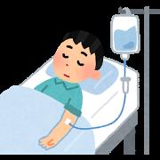 ベッドで点滴をしている患者