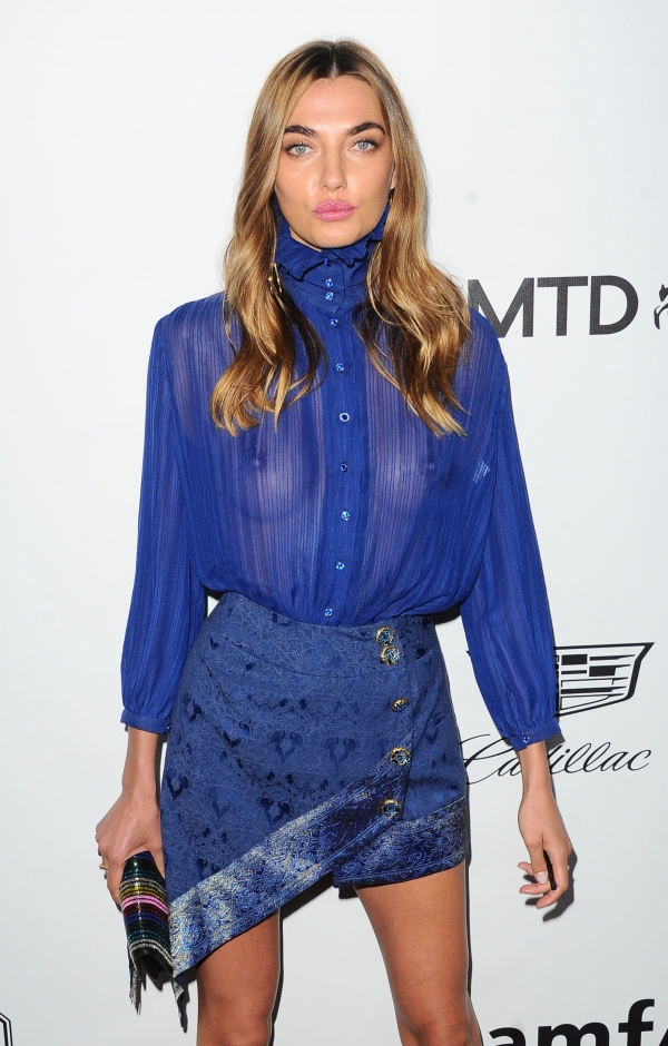 Alina Baikova wears a see through blue blouse without bra at the amfAR Inspiration Gala in Los Angeles, 10/13/2017.